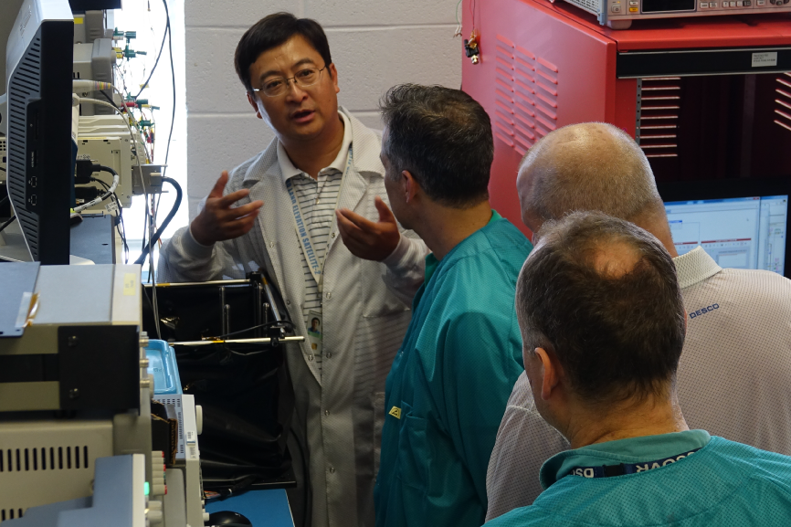 Wei Lu demonstrates the Front-End Electronics for the main instrument on PACE