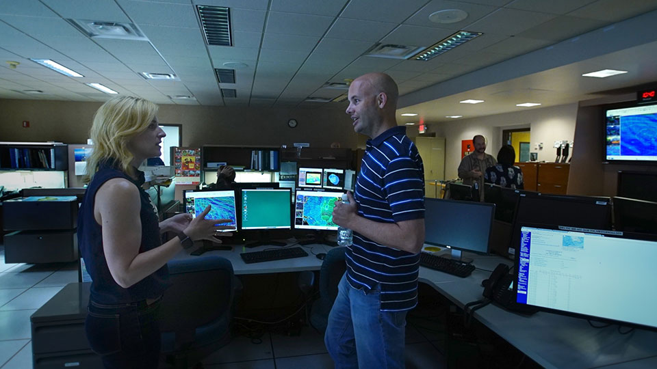 Meteorologist John Jelsema discusses an upcoming forecast with CORAL project scientist Michelle Gierach.