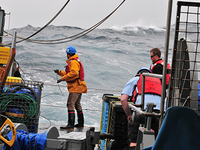Sampling in the open ocean presents many challenges, including the threat of rough seas and inclement weather. Credit: NASA/Goddard