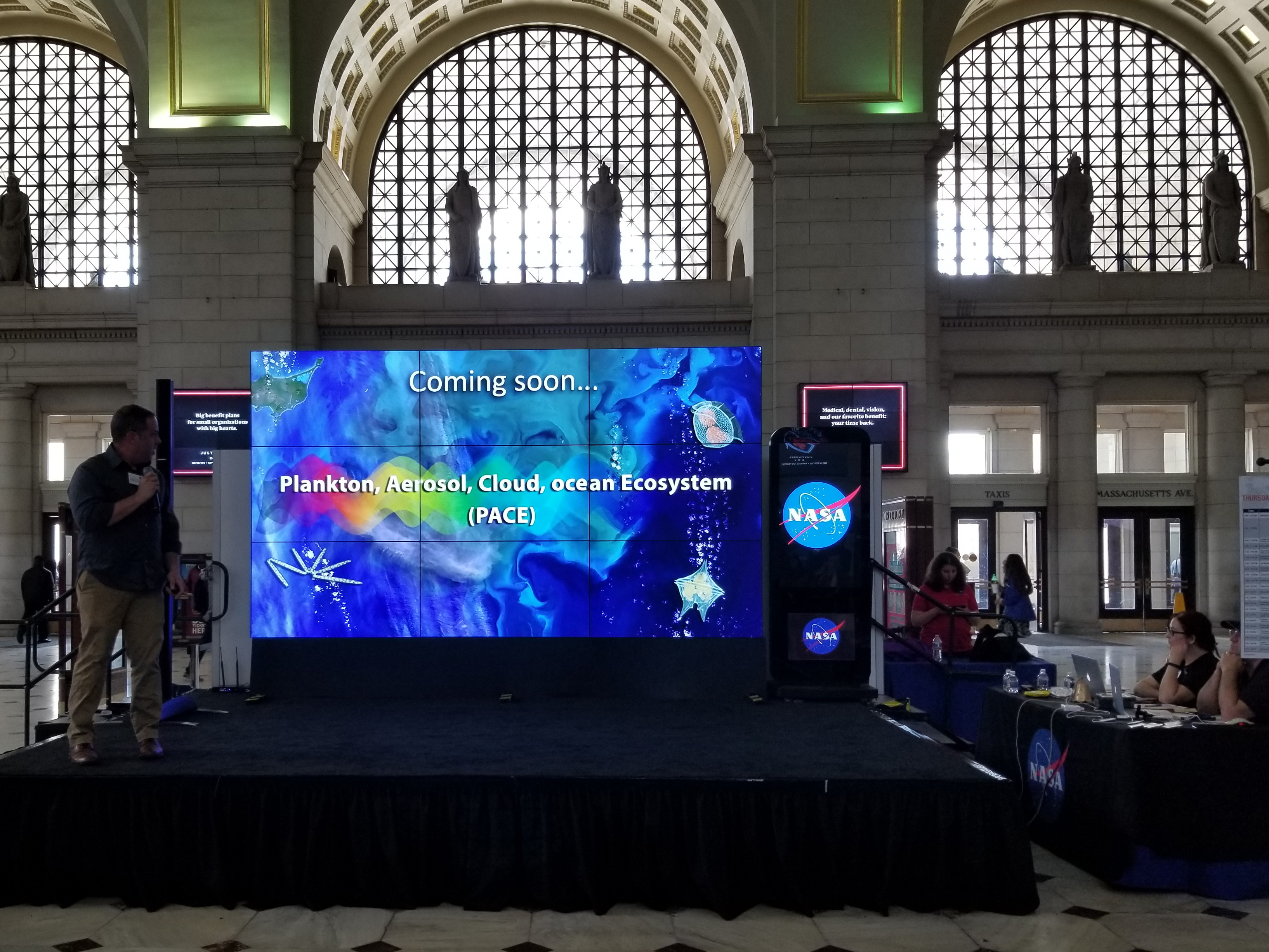 Dr. Jeremy Werdell, PACE Project Scientist, presents a hyperwall talk at the 2018 NASA Earth Day event at Union Station in Washington D.C.