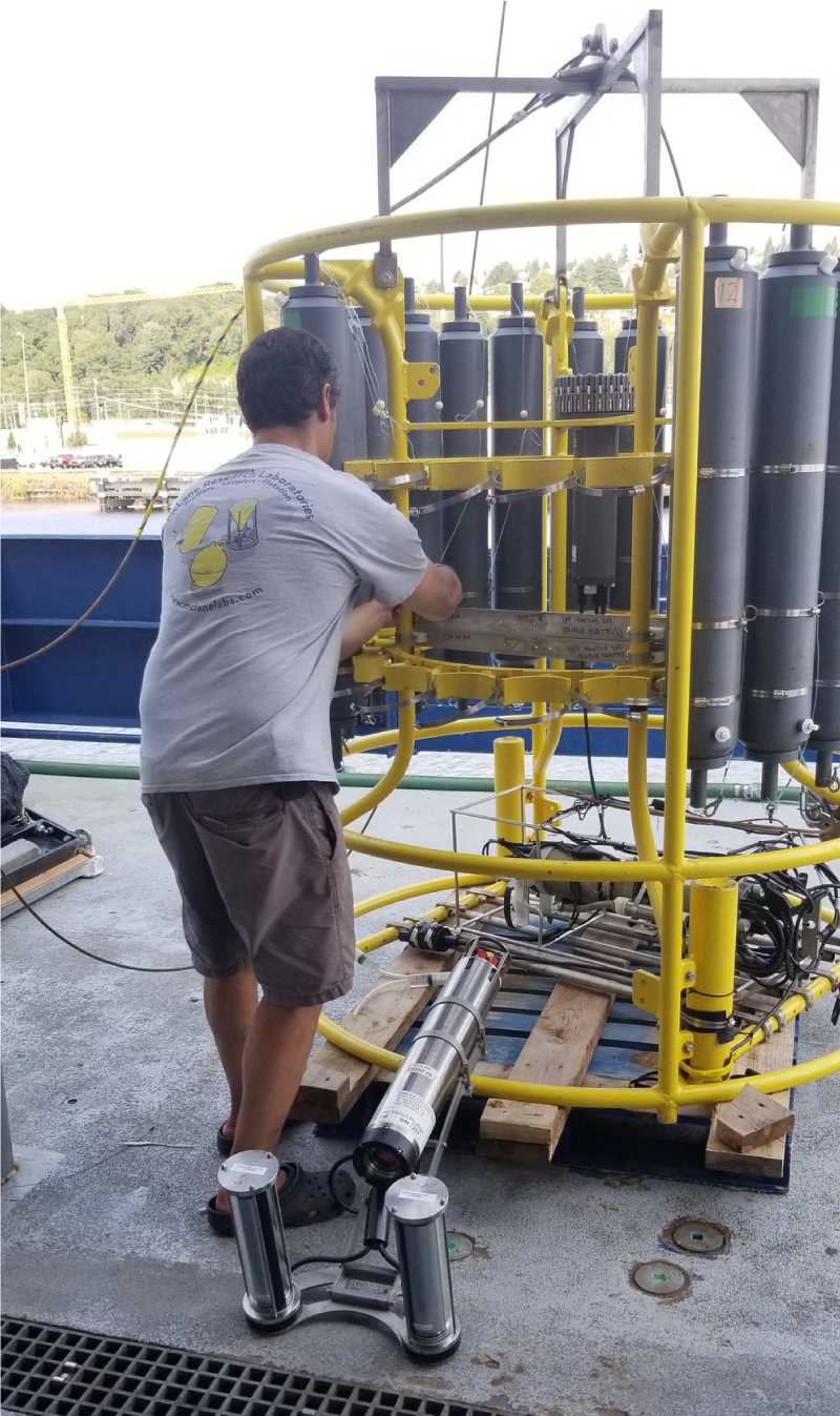Dr. Emmanuel Boss readies an Underwater Vision Profiler, which will be used by scientists from UMaine and UA Fairbanks to collect water samples on the EXPORTS cruise.