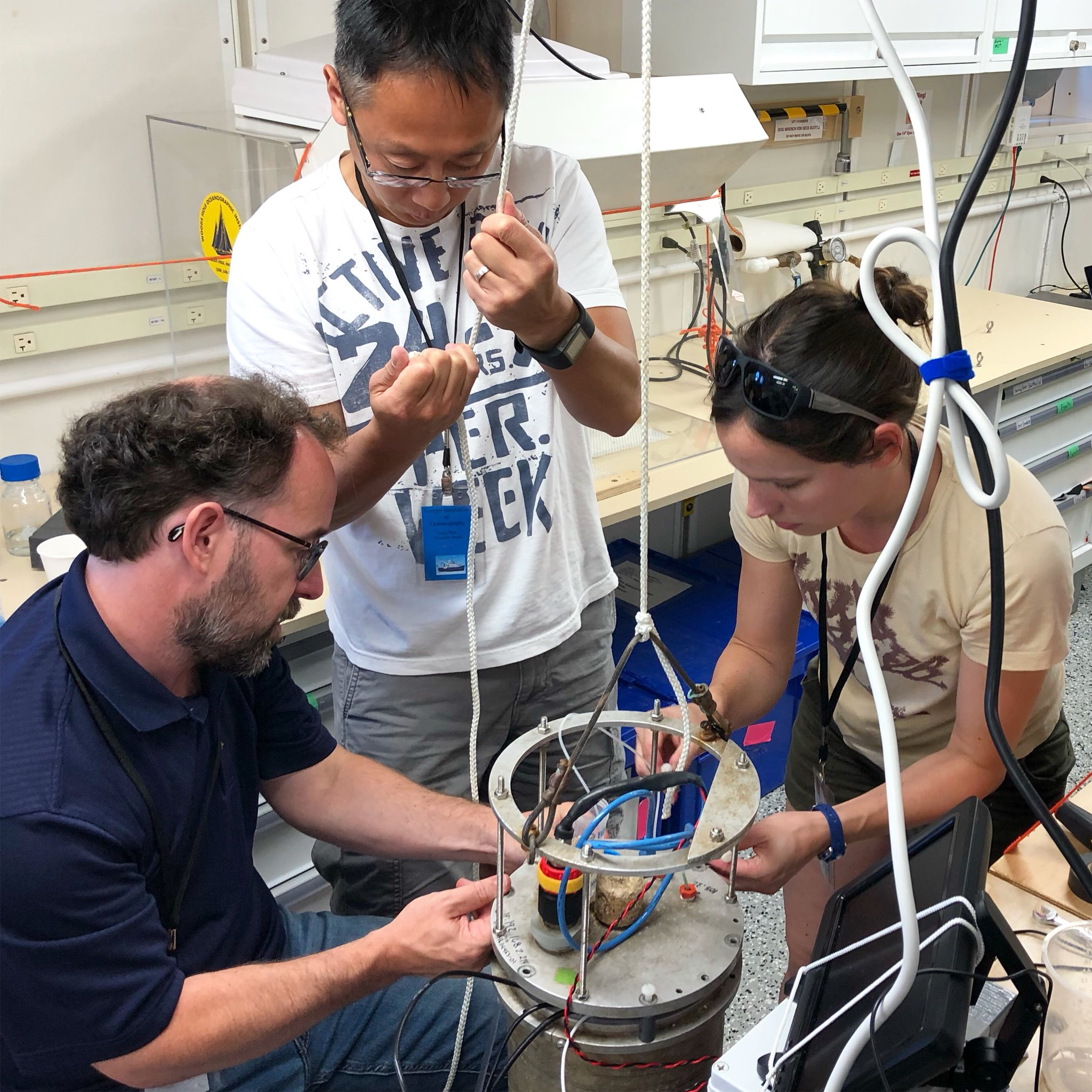 EXPORTS scientists prepare an IFC for operation on board the R/V <em>Sally Ride</em>.