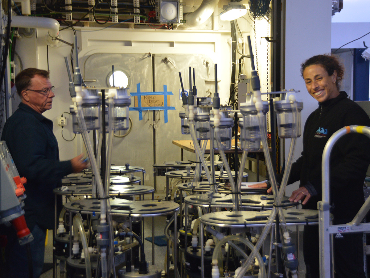Steve Pike and Claudia Benitez-Nelson prepare filtration pumps to be deployed. The pumps are equipped with filter heads that will collect marine particles from thousands of liters of seawater.