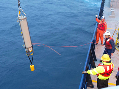 The EXPORTS team deploys this Marine Snow Catcher after several days of rough seas. These instruments sample water from the Twilight Zone - the focus of the cruise - so that scientists can better understand how phytoplankton and zooplankton impact how carbon is exported to the deep ocean. Credit: NASA