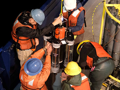 EXPORTS researchers delicately bring a Neutrally-Buoyant Sediment Trap onto the deck of the R/V <em>Roger Revelle</em>. Credit: NASA