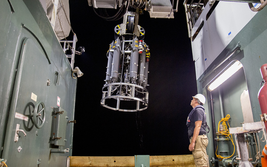 A CTD and water sampling system rosette is prepared for deployment on the R/V <em>Falkor</em>.