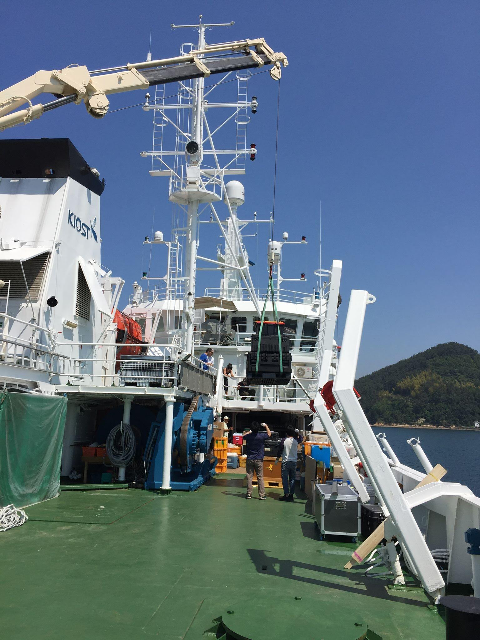 Equipment for the KORUS-OC campaign is carefully hoisted onboard the R/V <em>Onnuri</em> and stowed.