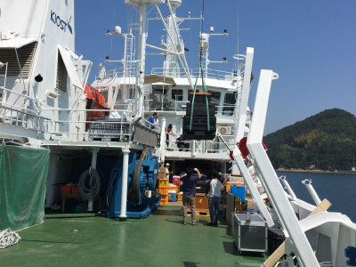 Equipment for the KORUS-OC campaign is carefully hoisted onboard the R/V <em>Onnuri</em> and stowed. Credit: Joaquim Goes