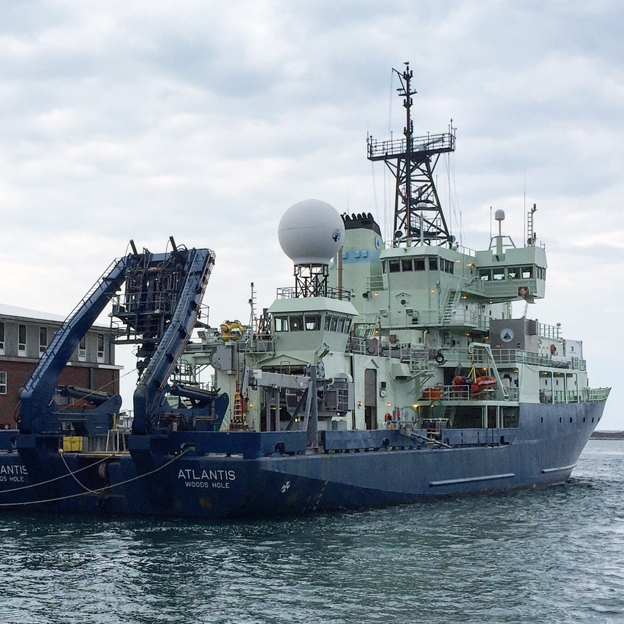 The R/V <em>Atlantis</em>, operated by the Woods Hole Oceanographic Institution (WHOI), in port.
