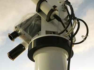 The radiometer installed on the bow of the R/V <em>Falkor</em> will take detailed measurements of water color, which can be compared to satellite ocean color measurements as well as in situ measurements of chlorophyll. Credit: Schmidt Ocean Institute