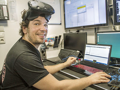 Benjamin Knorlein, a Computer Scientist from the Center for Computation and Visualization at Brown University, works on the design of software that will enable scientists to study plankton through virtual reality. Credit: Schmidt Ocean Institute